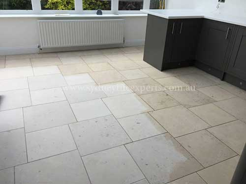 before and after Regrouting limestone tile