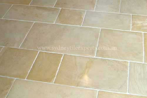 before and after Renewal limestone tile