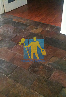 dirty and dull looking slate tiles requires stripping and sealing Sydney cleaning