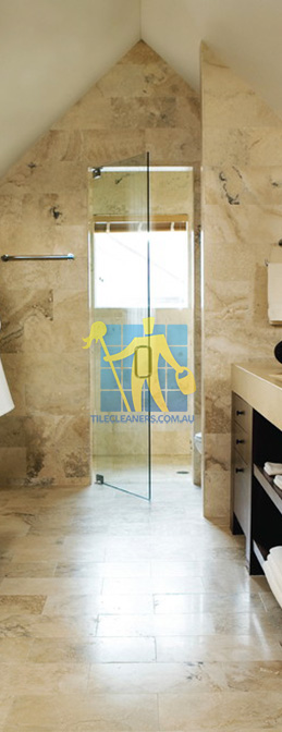 travertine tiles bathroom floor wall shower with dark veining Sydney